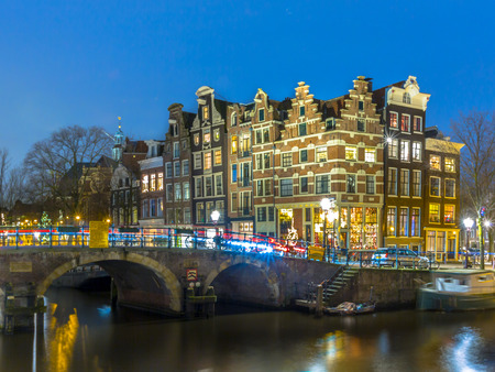 prinsengracht: Night shot of Colorful traditional canal houses on the corner of brouwersgracht and Prinsengracht in the UNESCO World Heritage site of Amsterdam