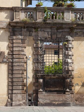 sightsee: Window in a Wall with Bars on Square in Lucca, Tuscany, Italy