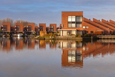 Modern water front houses in Leeuwarden Zuiderburen, the Netherlands photo