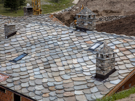 schist: Schist Roof Tiles Being Installed on a New House