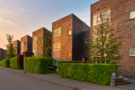 suburban neighborhood: Neighborhood with modern houses in a suburban street in afternoon sun Stock Photo