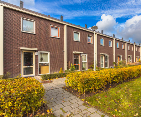 row of houses: Small Modern Row Houses in Europe Stock Photo