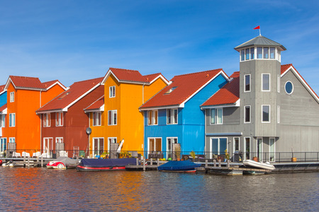 row house: Waterfront houses in various colors in Groningen, Netherlands Stock Photo