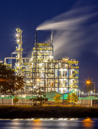 plant oil: Night scene of detail of a heavy Chemical Industrial plant with mazework of pipes and pipelines in twilight