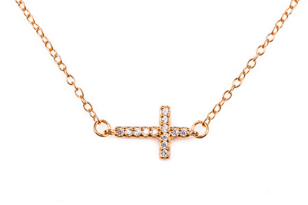 Golden christianity cross pendant with diamonds  on a chain photo