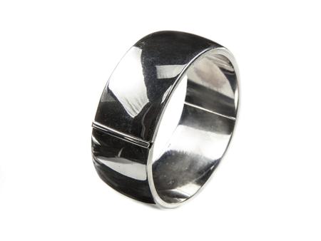 armlet: Plain large silver bracelet standing on white background Stock Photo