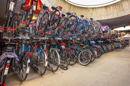 elected: Bicycle parking garage on Groningen Central. The city of Groningen has been elected  most cycling friendly city of the Netherlands for 3 years in a row. Stock Photo