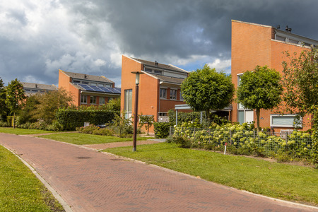 detached houses: Street with large detached houses in a suburb of Wageningen City, Netherlands