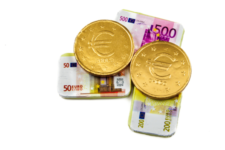 sinterklaasfeest: Chocolate coins and banknotes as a concept for unreliable financial bussiness Stock Photo