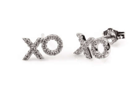 xoxo: Silver hugs and kisses earrings isolated on white studio background Stock Photo