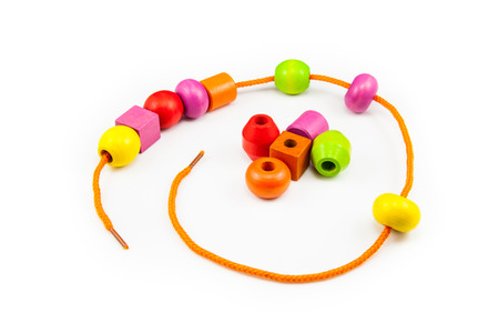 child s block: Wooden Beads on a String making a Colorful Toy Necklace