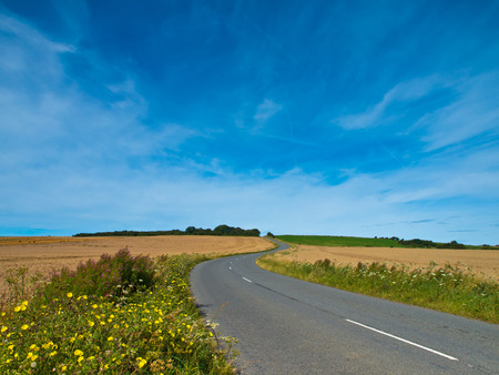 french countryside: Winding asphalt road in french countryside Stock Photo
