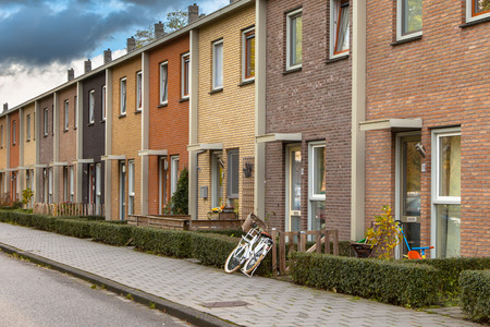 Modern Terra Colored Middle Class Terraced Houses in the Netherlands, Europe Stock Photo