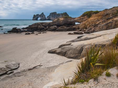 new zealand beach: Rock formations on Wharariki Beach, North Island, New Zealand Stock Photo