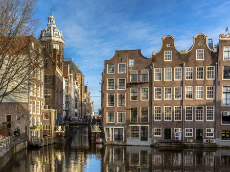 canal houses: Colorful historical canal houses seen from the armbrug in Amsterdam Stock Photo