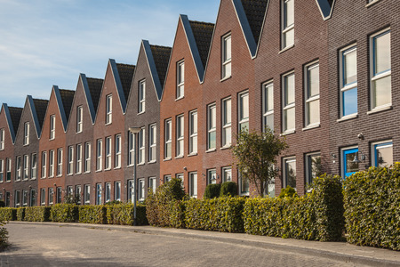 terraced: Row of Uniform Family House in a Quiet Street in the Netherlands