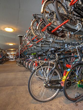 parking station: Bicycle parking on Groningen central station. The city of Groningen has been voted  most cycling friendly city of the Netherlands for 3 years in a row. Editorial
