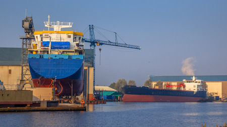 shipway: Cargo vessels being Constructed on a small Wharf in the Netherlands