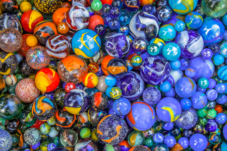 marble background: Background of colorful glass bonce in blue and orange as a concept for diversity