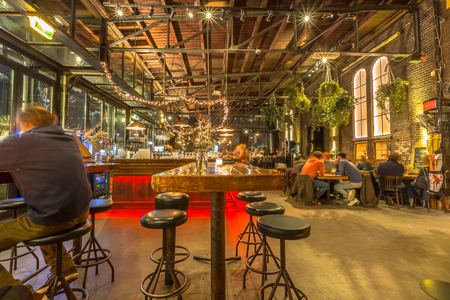 Interior of a cafe in the former Western Gas Factory or Westergasfabriek in Amsterdam. Nowadays a Public place for creative events like music and art. Redactioneel