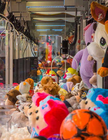 cent: Claw crane with soft cuddly toys in an arcade machine