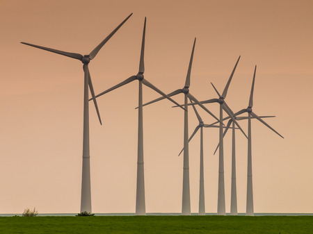 windturbines: Row of windturbines on the dutch coast at sunset