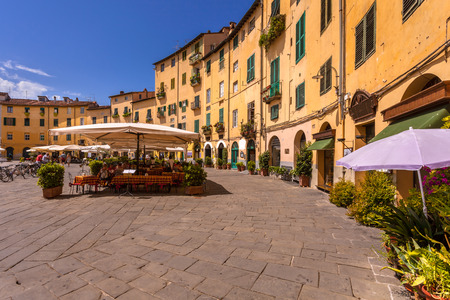 piazza: The touristic Oval City Square on a Sunny Day in Lucca, Tuscany, Italy
