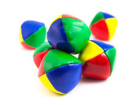 proficiency: Concept for Business Challenges, Stack of Colorful Juggling Balls on White Background