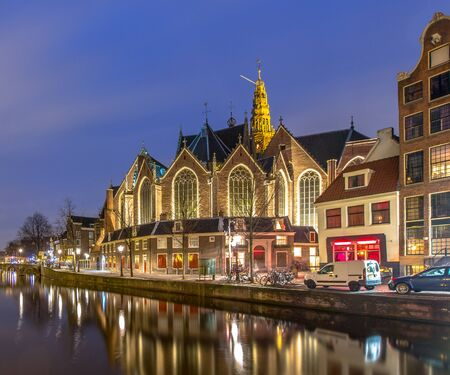 red light district: Nightscape of the old church or oude kerk on the oudezijds voorburgwal in the red light district of Amsterdam