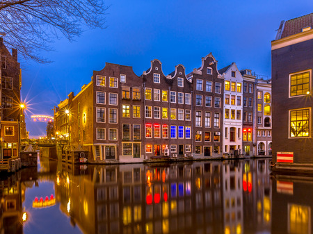 canal houses: Traditional colorful canal houses in the early night during the blue hour seen from the Sint Olofsteeg Stock Photo