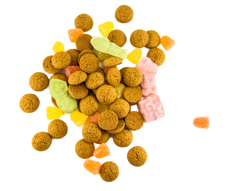 pepernoot: Sinterklaas background with pepernoten and candy for dutch sinterklaasfeest holiday event on december 5th Stock Photo