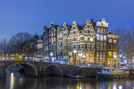canal houses: Night shot of Colorful traditional canal houses on the corner of brouwersgracht and Prinsengracht in the city centre of UNESCO World Heritage site Amsterdam Editorial