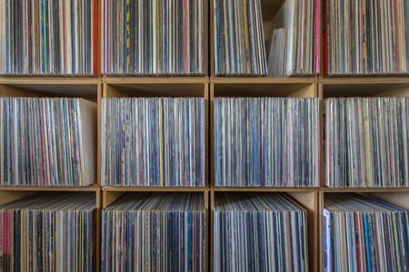 Huge record collection ordered by music style on many shelves