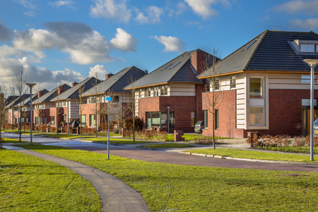detached houses: Detached dutch family houses along a suburban street in winter, Groningen, Netherlands Stock Photo