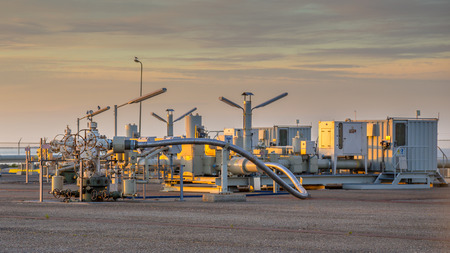 compressor: Oil and gas processing plant in the Waddensea area with pipe line valves Stock Photo