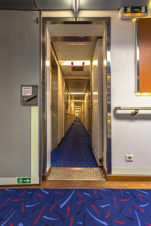 recedes: Cruise ship corridor leading to rooms recedes into the distance Stock Photo