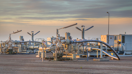 Natural gas production plant in the Waddensea area with pipe line valves Stock Photo