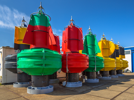 buoys: Colorful Nautical Buoys in a storage area. Required to maintain shipping traffic routes at sea for export purposes