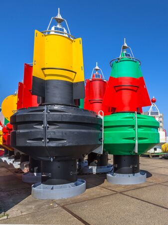 buoys: Nautical Buoys in a storage area.  Required to maintain shipping traffic routes at sea for export purposes