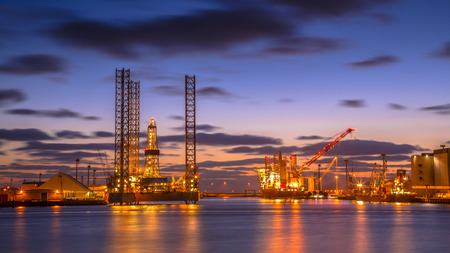 oil platforms: Oil Platforms being built in a manufacturing harbor under beautiful sunset