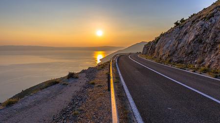 mediteranean: Road to orange sunset on an island in the mediteranean sea