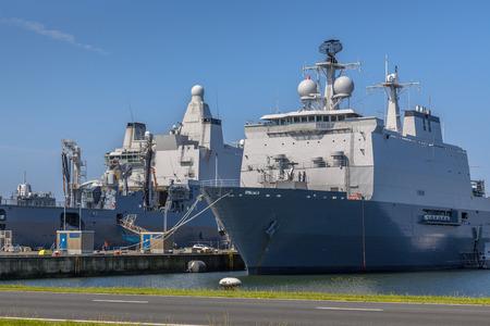 den: Dutch navy ships in a harbor, loading for their next mission at Den Helder naval base Editorial