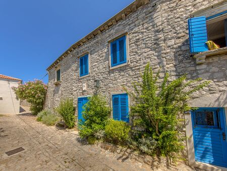 traditional house: Traditional Croatian apartment complex with blue painted windows in town of Osor on Cres Island, Istria, Croatia, Europe