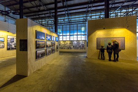 exhibition crowd: GRONINGEN, THE NETHERLANDS - SEP 27, 2015: Visitors at Photo exhibition Noorderlicht Data Rush in oude suikerfabriek Groningen.