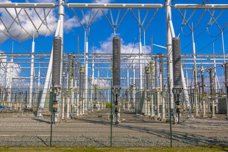 isolator insulator: Modern high-voltage Power substation with switch on blue sky background