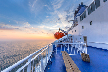 embarked: Deck on Ferry sailing across the Northsea during beautiful sunset Stock Photo