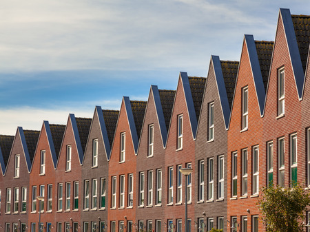 row of houses: Facades of Modern Real Estate Family houses in a row Stock Photo