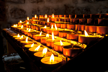 votive: Votive Candles in a Group burnt to pray for a loved one