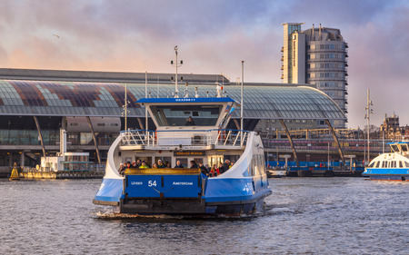 ferryboat: AMSTERDAM-DEC. 28, 2015. Ferryboat on Dec. 28, 2015 in Amsterdam. Several modern designed Ferryboats provide the daily connection between Central Station and Buiksloterweg, crossing the river IJ.
