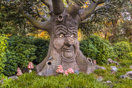 fairytale: Talking tree with happy face as a concept for environmental awareness Stock Photo